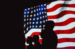 silhouette of people beside usa flag
